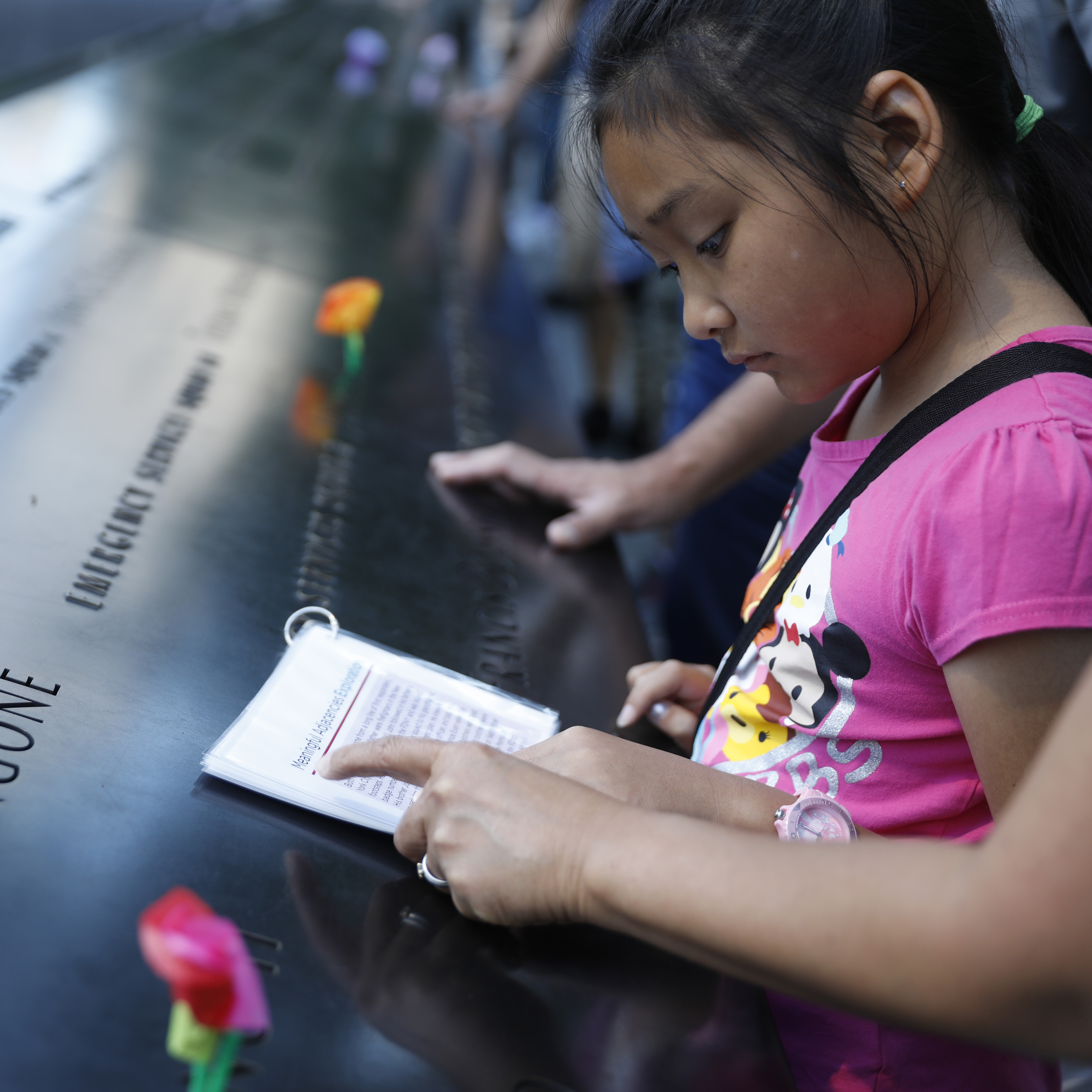 A child learns about the tragedies of 9/11 at the memorial