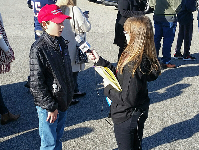 Kaitlin interviews a Trump supporter at rally in rally in Portsmouth, New Hampshire