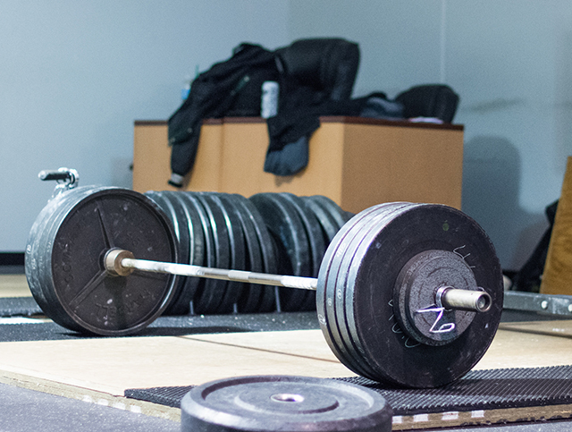 Loaded barbell (Photo by Lance Goyke)What does it take to be the best? Powerlifter Naomi Kutin found out.