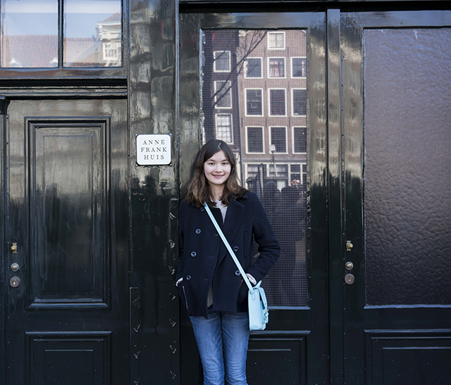 Charlotte stands outside the house in which Anne Frank hid. It's located in the back of her father's office building, in the heart of Amsterdam.