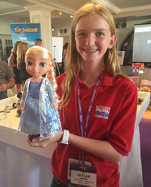 "Skylar checks out Disney Frozen Northern Lights Elsa, a Toy Insider Hot 20 toy. This new Elsa doll sings ""Let It Go"" and the lights on her dress sparkle when kids hold a hand over her snowflake."