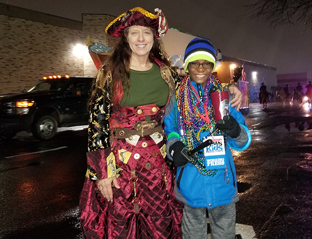 Owen with Helen Phares, captain of a Mardi Gras krewe and coordinator of the Children's Parade in Bossier City