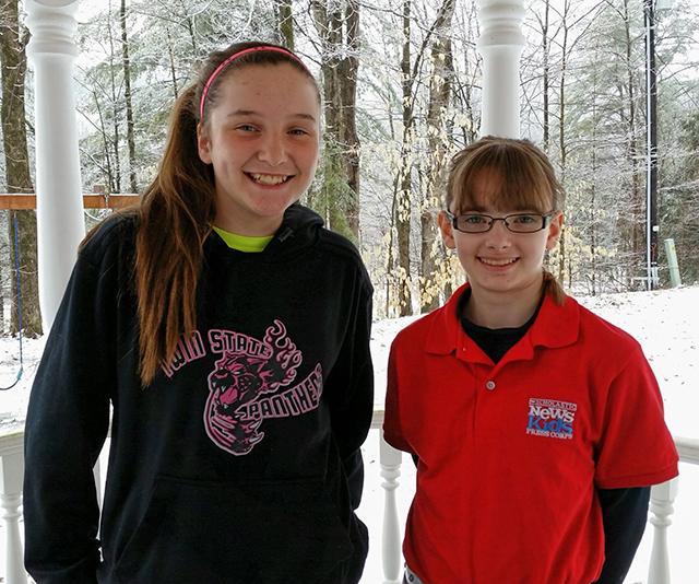 Kid Reporter Kaitlin Clark and Delaney Pickering in her basketball team sweatshirt.
