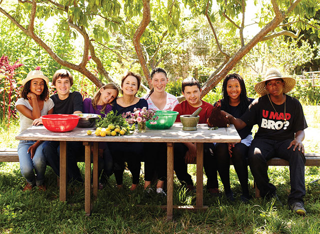 As part of her Edible Schoolyard Projects, Chef Alice Waters (center) encourages schools to create gardens, allowing students to grow their own fruits and vegetables. Waters co-founded Chez Panisse, one of the country's first farm-to-table restaurants, in 1971.