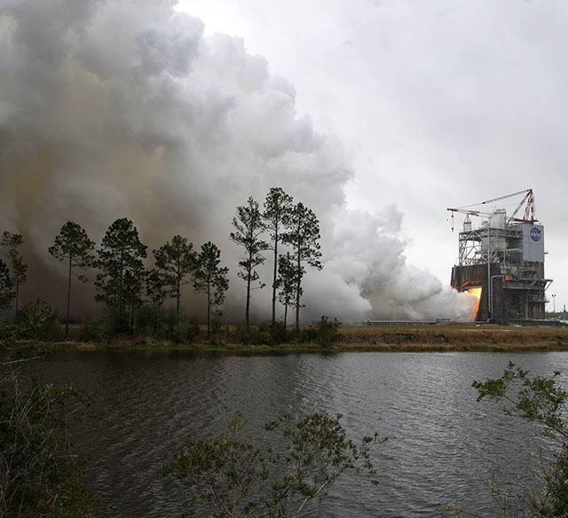 On March 10, NASA engineers conduct a successful test firing of RS-25 rocket engine No. 2059 on the A-1 Test Stand at Stennis. The hot fire marks the first test of an RS-25 flight engine for NASA's new Space Launch System vehicle.