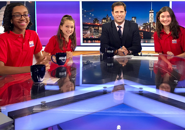 Left to right: Kid Reporters Christina Lilavois, Amelia Poor, and Charlotte Fay discuss the New York City mayoral race with NY1 news anchor Josh Robin.