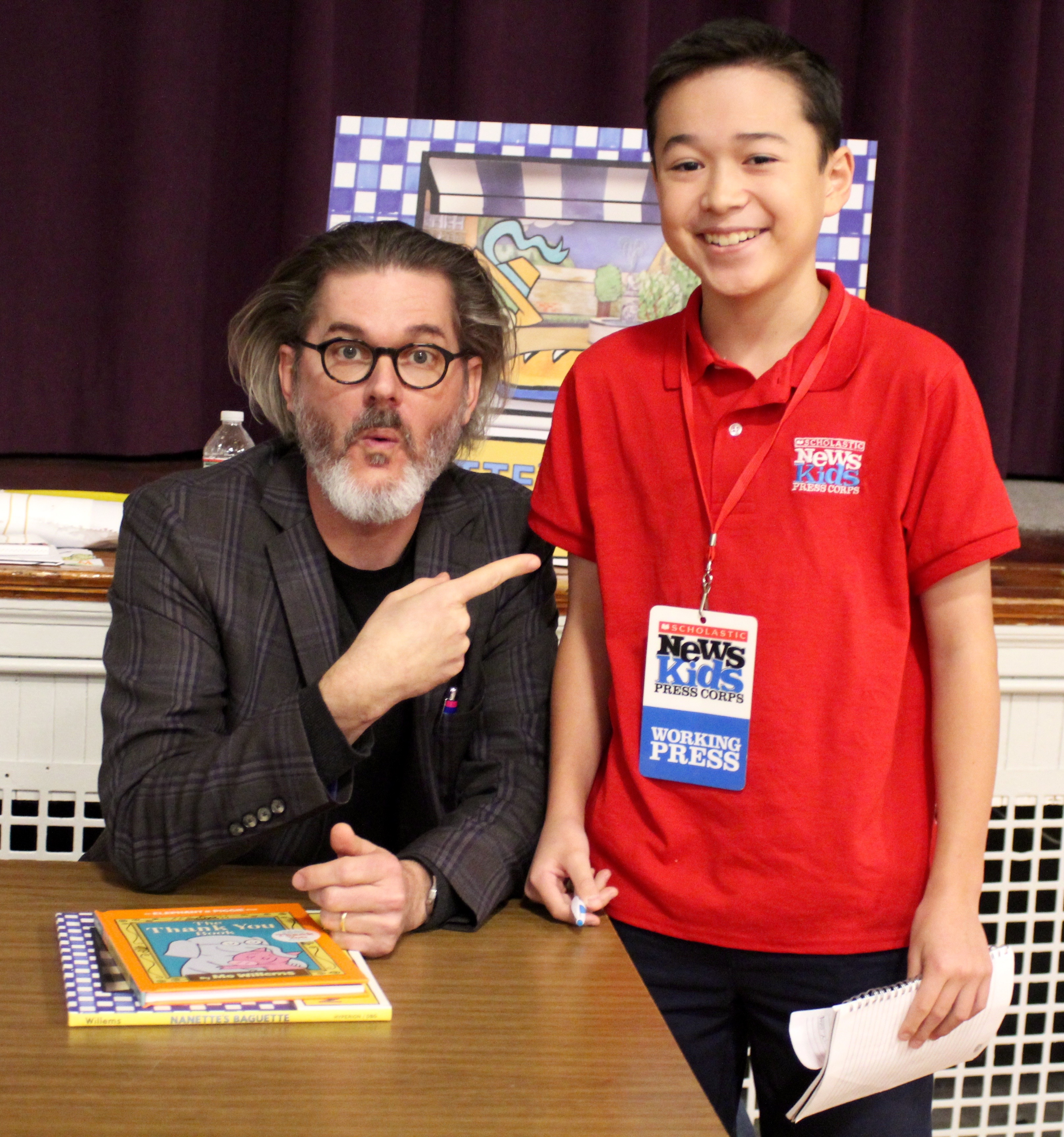 Max wows children's book author and illustrator Mo Willems at the Mother Brook Arts and Community Center in Dedham, Massachusetts.