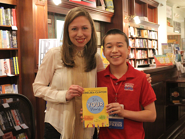 "Max and Chelsea Clinton holding ""It's Your World: Get Informed, Get Inspired, & Get Going"" at R.J. Julia Booksellers in Madison, CT"