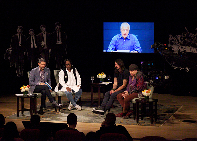 Left to right: Scholastic Vice President Billy DiMichele, Whoopi Goldberg, Dave Grohl, and Stevie Van Zandt talk about the influence of the Beatles at a Scholastic event celebrating the British rock group's influence. Larry Kane shares his thoughts via satellite.