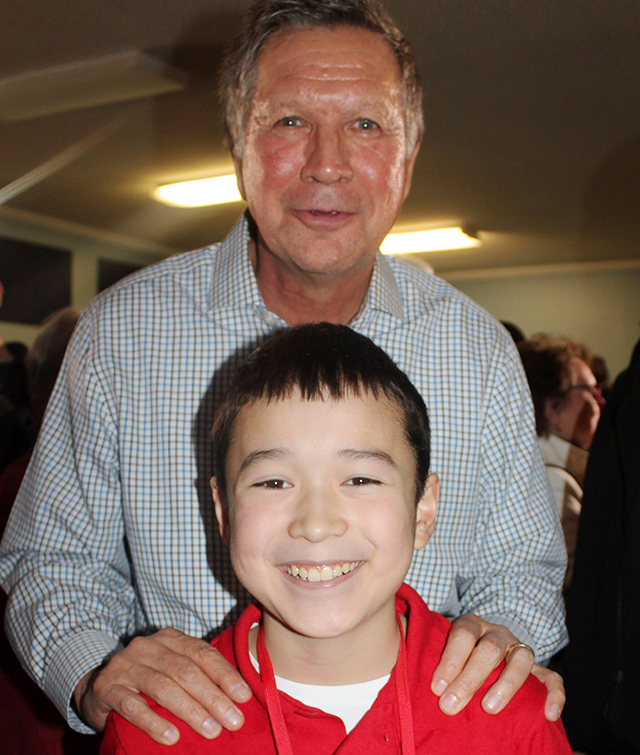 """Ohio Governor John Kasich with Maxwell Surprenant at a """"town hall"""" event in Goffstown, New Hampshire."""