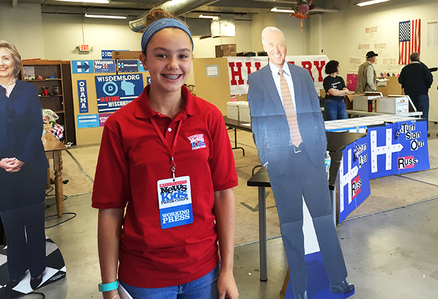 Lilian with cardboard cutouts of Clinton and Biden