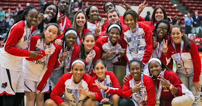 Hoop star Maria Alvarez (front row, second from left) celebrates with her Miami Country Day teammates after winning the DICK's Sporting Goods High School Nationals on April 4 at Madison Square Garden.