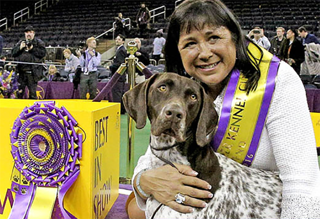 Valerie Nunes-Atkinson poses with her dog C.J. after their win at the Westminster show on February 16. C.J.'s full name is California Journey. He is the third German shorthaired pointer in the show's history to take top honors.