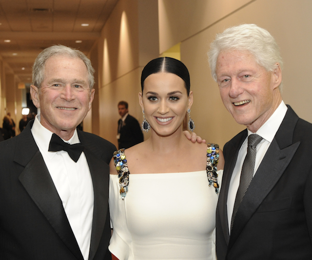 Former Presidents George W. Bush and Bill Clinton with Katy Perry at the Starkey awards gala. Photo by Greg Jansen.