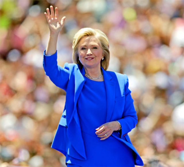 Former Secretary of State Hillary Clinton waves to supporters on June 13 at a park on Roosevelt Island in New York City.