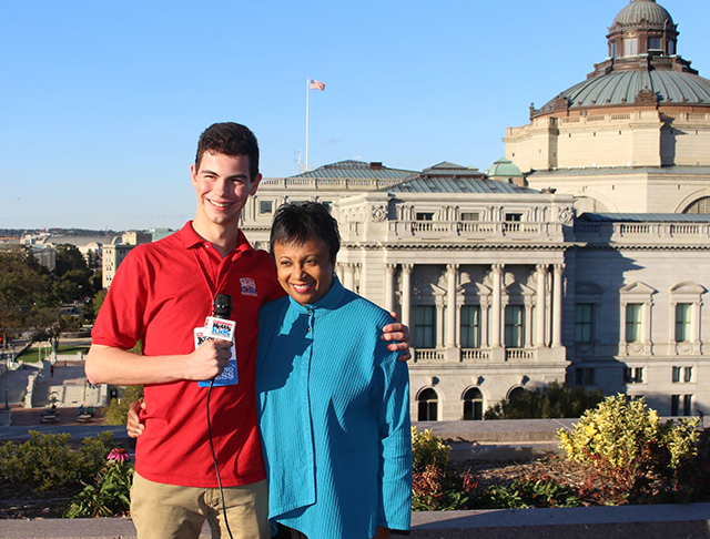 Kid Reporter Erik Weibel with Carla Hayden, the new librarian of Congress, outside the Library of Congress in Washington, D.C. The library was established by an act of Congress in 1800.
