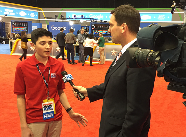 Scholastic News Kid Reporter Gabriel Ferris is interviewed by a TV reporter at a debate in New Hampshire.