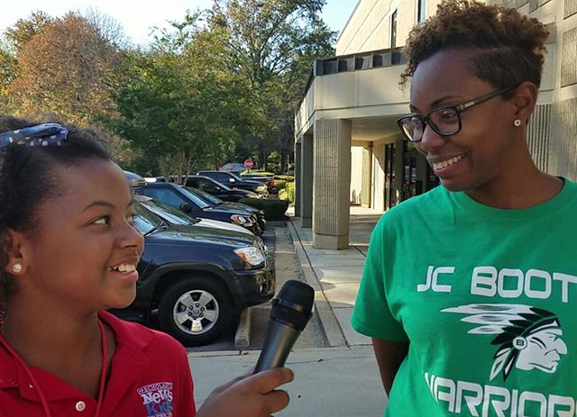 Genesis talks with voter Dreeka Owens in Peachtree City, Georgia.