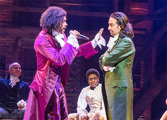 Daveed Diggs (front left), Lin-Manuel Miranda (front right), and other cast members perform in Miranda's Hamilton: An American Musical at the Richard Rodgers Theater in New York City.