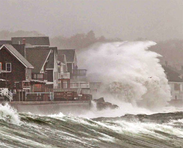 Waves crash over a seawall in Scituate, Massachusetts, on the eve of Hurricane Sandy in October 2012. The superstorm claimed more than 230 lives in the United States and caused an estimated $65 billion in damages.