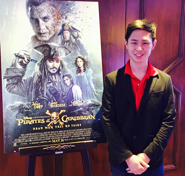 Jeremy Hsiao in front of Pirates of the Caribbean: Dead Men Tell No Tales poster