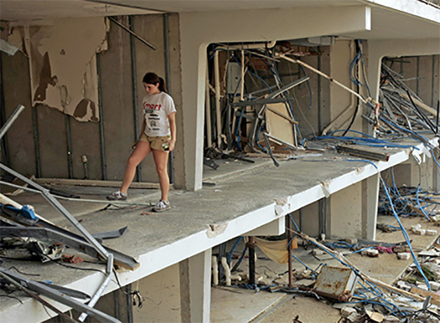 A girl walks through her ruined apartment building in Biloxi, Mississippi. Hurricane Katrina caused extensive damage in the Southeast in August 2005.