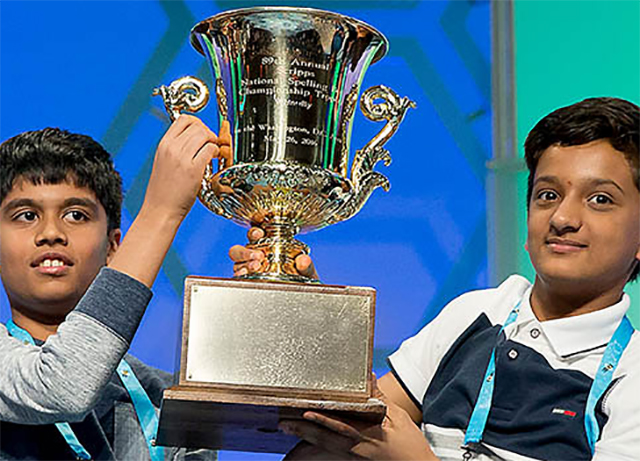 Nihar Janga (left) and Jairam Hathwar hoist the Scripps National Spelling Bee trophy after being named co-champions on May 26 in National Harbor, Maryland.