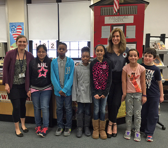 Students and Library Media Specialist at Kelly Elementary School (West Orange, NJ) pose with Lauren Tarshis.