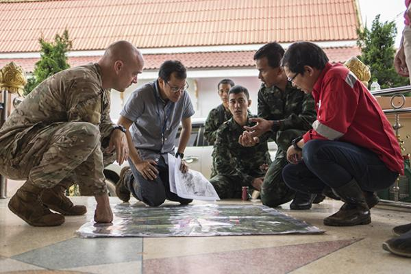 Airmen from the U.S. Indo-Pacific Command meet with Thai military officials and a Thai engineering company in Chiang Rai, Thailand, to advise and assist in the operation to rescue members of a soccer team and their coach.
