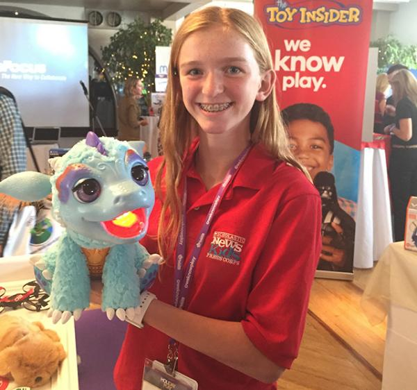 "Kid reporter Skylar Yarter with Furreal Friends Torch My Blazin' Dragon from the Toy Insider Hot 20 list. This toy breathes flame-colored mist that can ""toast"" a color-changing marshmallow treat."