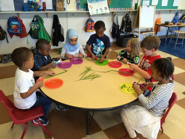 Preschool children learn about healthy eating. Studies show that a quality education early in life offers lasting benefits.
