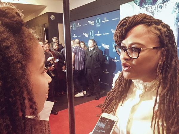 Adedayo talks with director Ava DuVernay at a screening of A Wrinkle in Time in New York City.