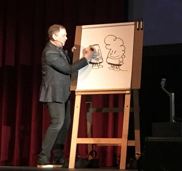 Dav Pilkey draws a picture of George and Harold who are best friends in his Captain Underpants series.