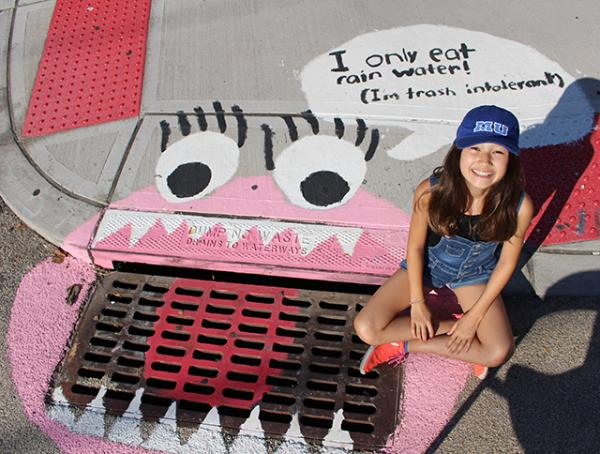 Ava Park-Matt painted this drain mural in Hoboken, NJ with her Girl Scout troop.
