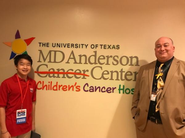 Benjamin with Kevin Long, director of pediatric operations at the children's hospital at MD Anderson Cancer Center in Houston, Texas