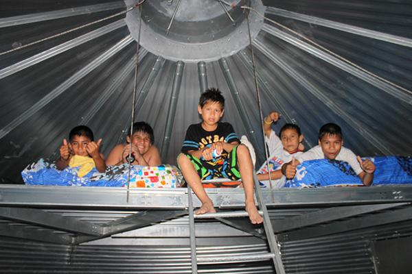 Kids climbing in the loft of a Safe T Home. Photo by Sukup Manufacturing