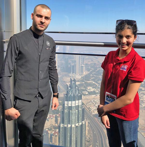Manat with Mohammed Kitabi, guest ambassador at the Burj Khalifa, the world's tallest building.