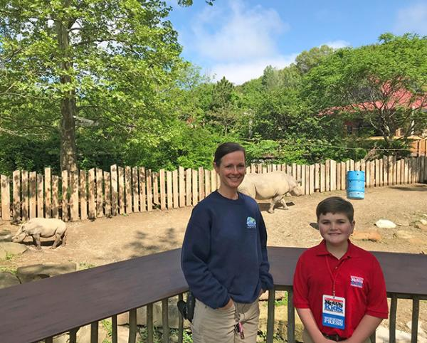 Nolan with Claire Winkler, animal keeper at the Cleveland Metroparks Zoo in Ohio.