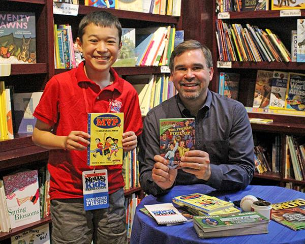 Max with David Kelly at a book-signing event in Dedham, Massachusetts
