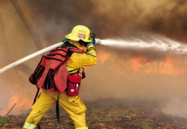 Firefighter Joel Mendoza chases down a wall of flames in Las Lomas, California.