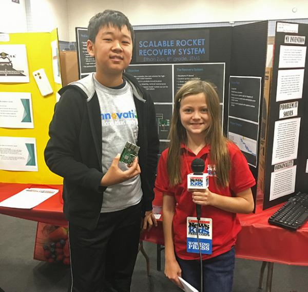 Kid reporter Annika Petras with 8th  grader, Ethan Zou, Jeffrey Trail Middle School, creator of the Scalable Rocket Recovery System.
