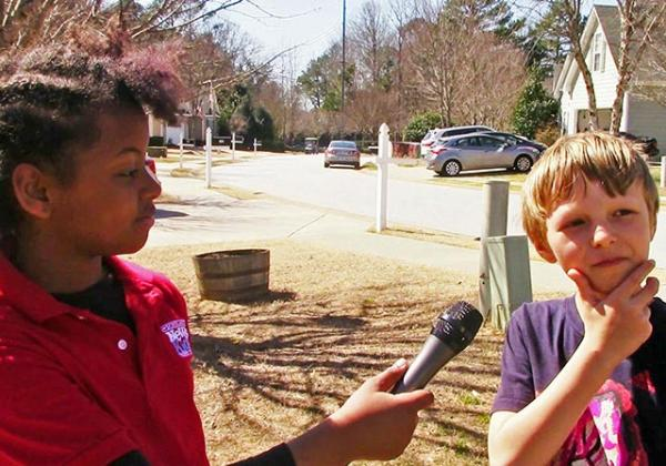 Genesis with Ethan Thompson, 8, who contemplates what he's looking for in a presidential candidate