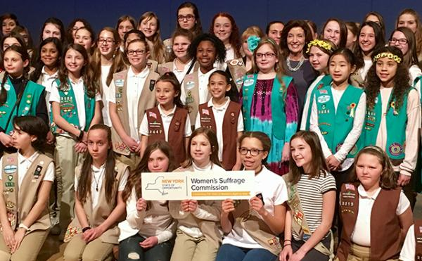 Girl Scouts in New York celebrate the creation of a badge honoring women's suffrage.