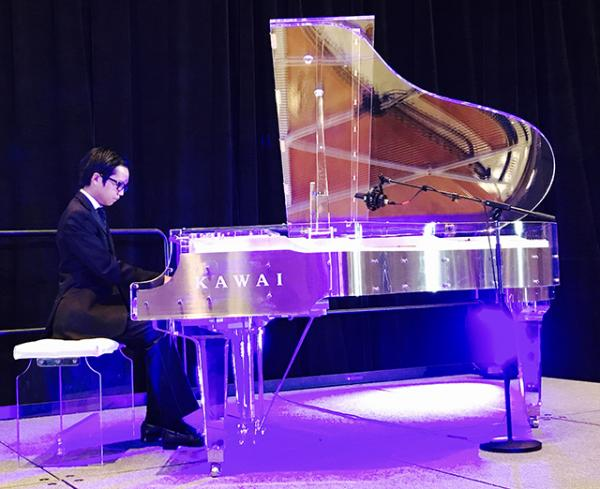 "Ethan performing on a Kawai CR 40 ""crystal"" piano"
