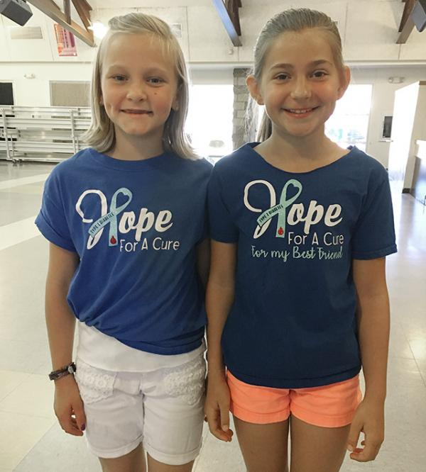 Best friends Ella and Saylor with 'Hope For a Cure' t-shirts.