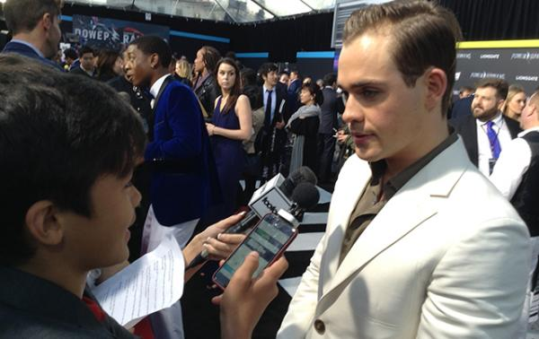 Scholastic News Kids Press Corps Reporter Ben Jorgensen interviews actor Dacre Montgomery at the premiere of Saban's Power Rangers.