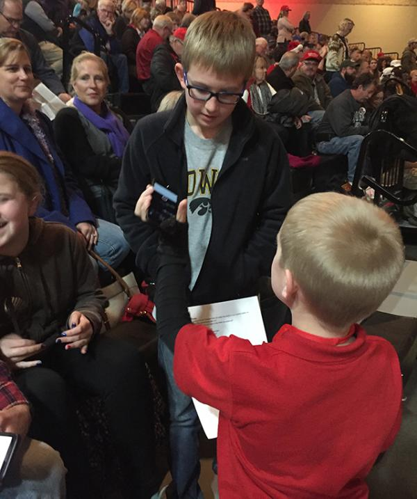 Anthony Fugere, 9, from Ames, Iowa discussing why he came to tonight's rally.