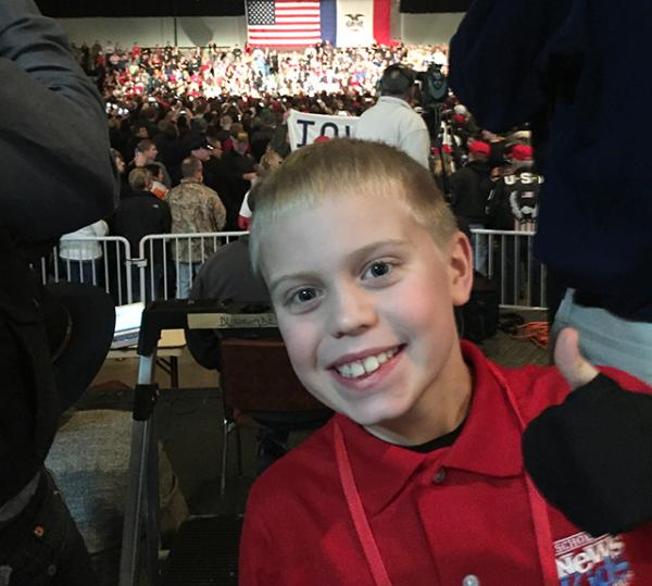 Kid Reporter Brandon getting ready to listen to President-Elect Trump give his speech.
