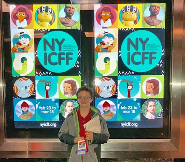 Josh in front of the NYICFF poster