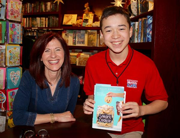 Max with children's author Elly Swartz at her book launch for Smart Cookie at Blue Bunny Books in Dedham, Massachusetts